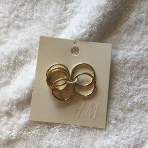 H&M package of goldtone rings with bonus